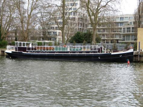 Thames Venturer in front of Kingston apartments